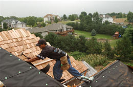 Roofer installing cedar shingles - Jobs for Felons